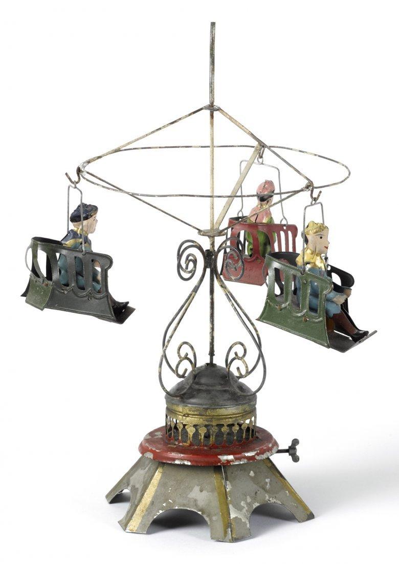 Painted tin clockwork musical carousel roundabou