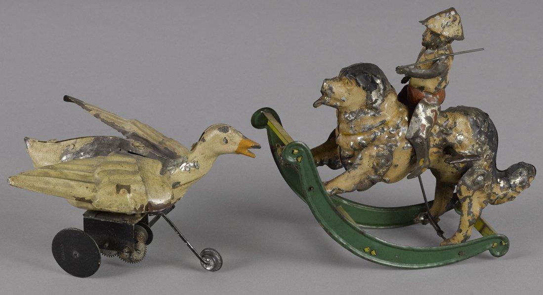 Gunthermann painted tin clockwork boy riding a d