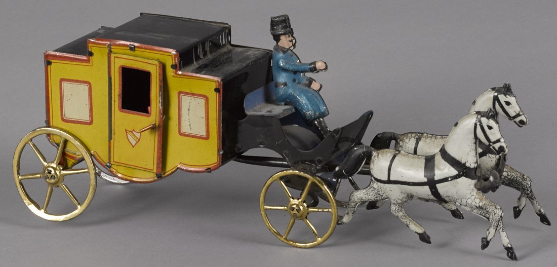 Tin lithograph horse drawn coach floor toy with