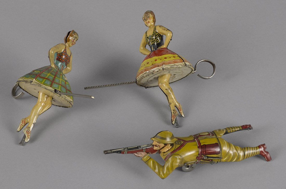 Pair of Marx tin lithograph ballerina tops, 5 1