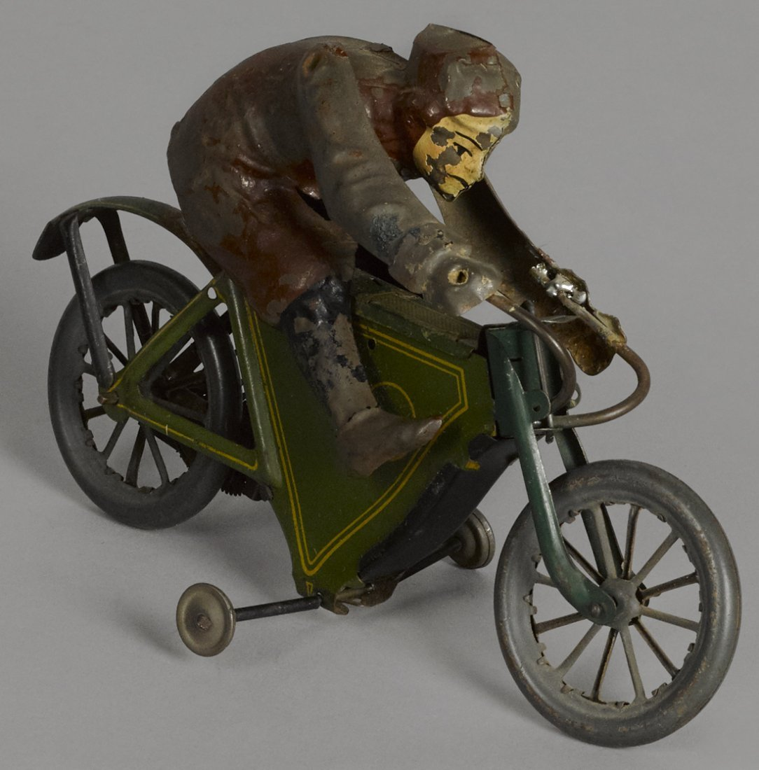 German lithograph tin clockwork motorcycle, 7 1