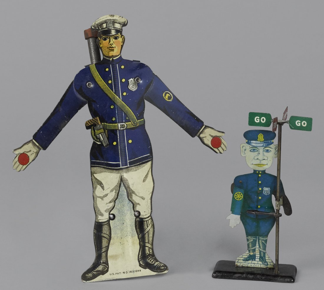 Tin lithograph animated policeman vehicle signal