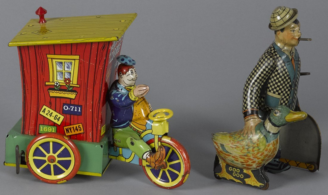 Two tin lithograph wind-up toys, to include a W