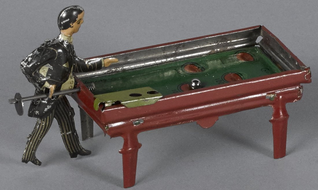 German tin lithograph pool player penny toy, 4''