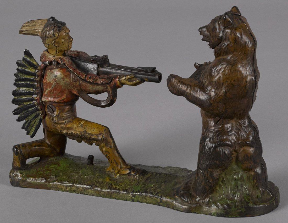 J. & E. Stevens cast iron Indian shooting bear m