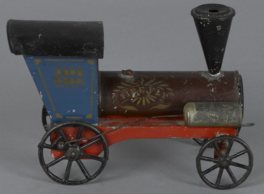 Early American tin Firefly floor train, 7'' l.
