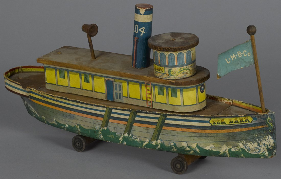 Paper lithograph over wood Sea Lark toy ship,