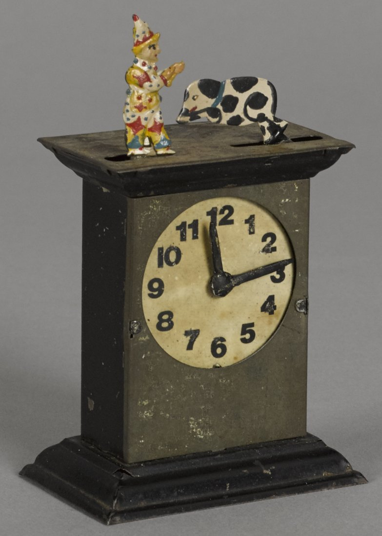 Animated painted tin clock penny toy, as the cl