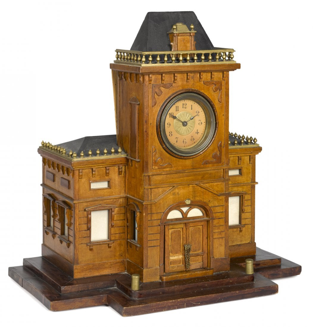 Building-form letter box with clock and music bo