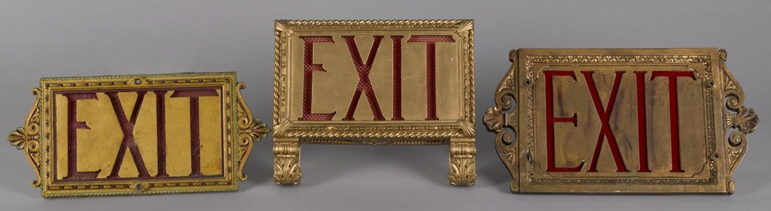 Three theater Exit signs, translucent red pan