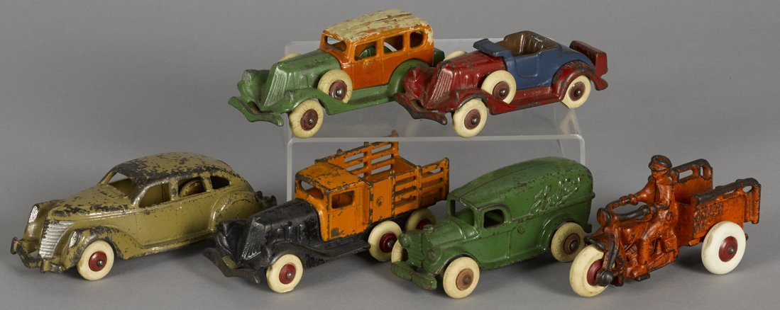Six small cast iron Hubley vehicles, to include