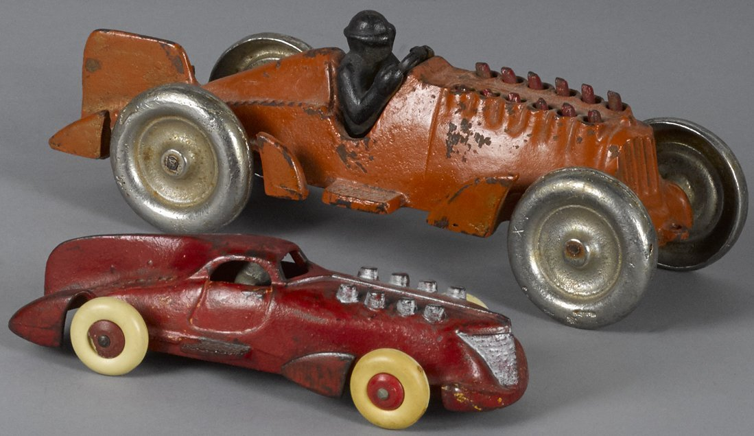 Two Hubley cast iron race cars, one having oper