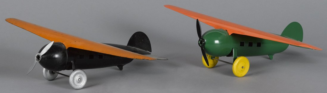 Two Marx pressed steel airplanes with wooden wh