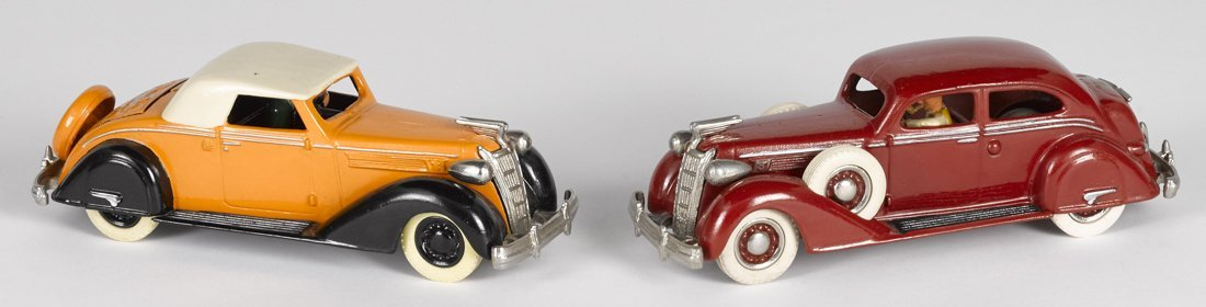 Two contemporary Tom Sehloff cast iron Chryslers