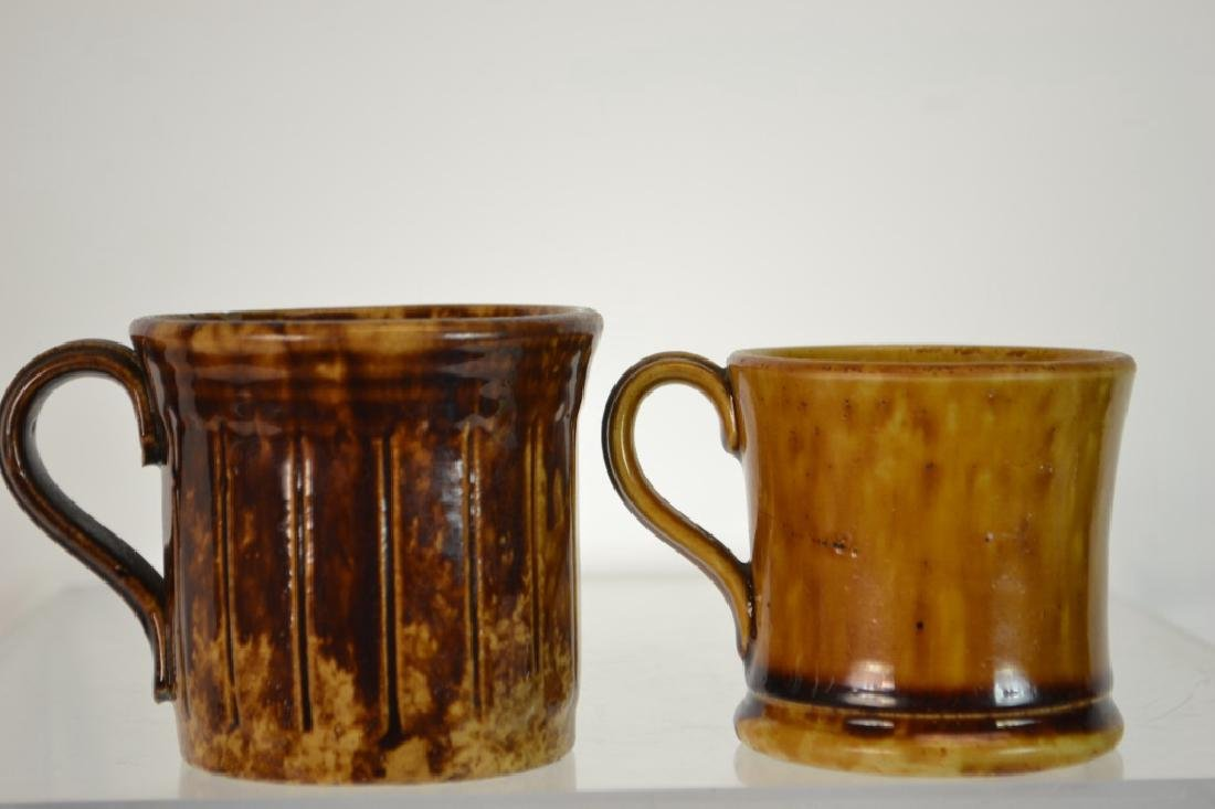 Two Rockingham-Bennington Pottery Mugs