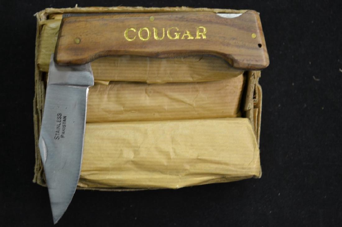 12 Cougar Pocket Knives