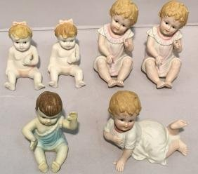 Collection of Six German Bisque Piano Babies