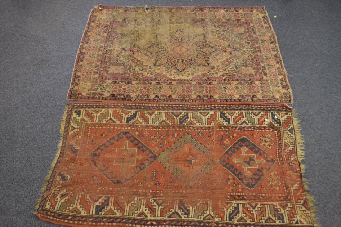 Pair of hand made semi antique persian style rugs.