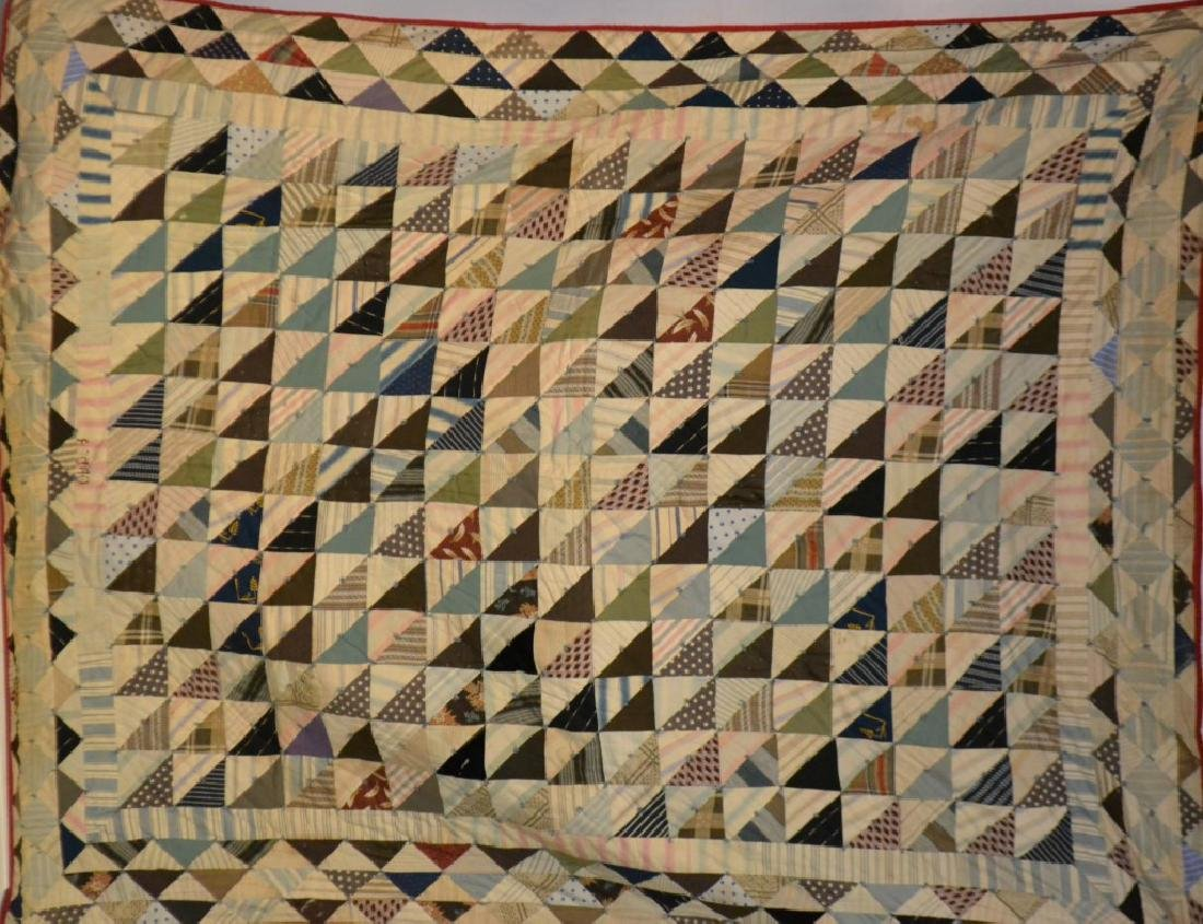 """Piece Triangle Quilt Measures approx. 82""""h x 64""""w."""