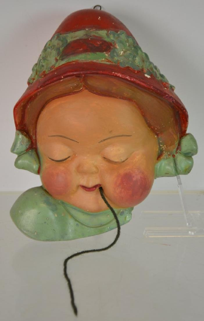 Figural String Dispenser Depicts a little girl's face