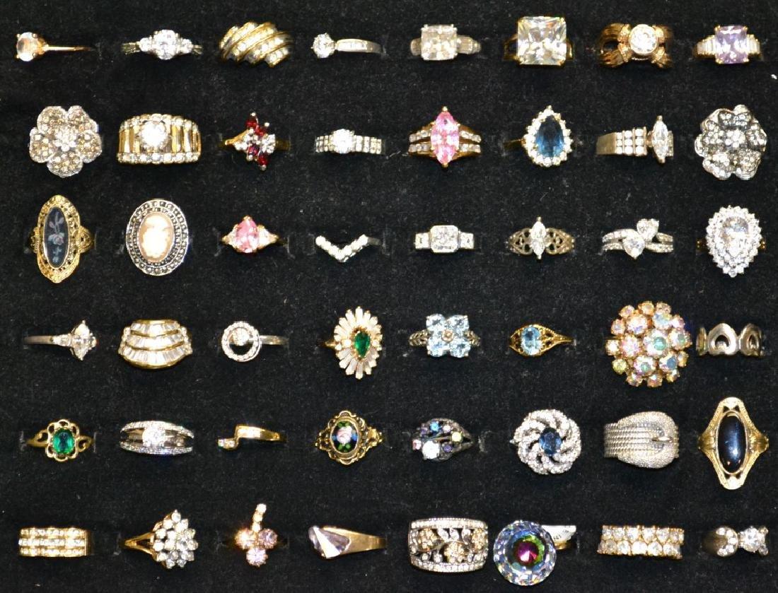 48 Ladies Rings 48 rings approx. 10 are sterling.