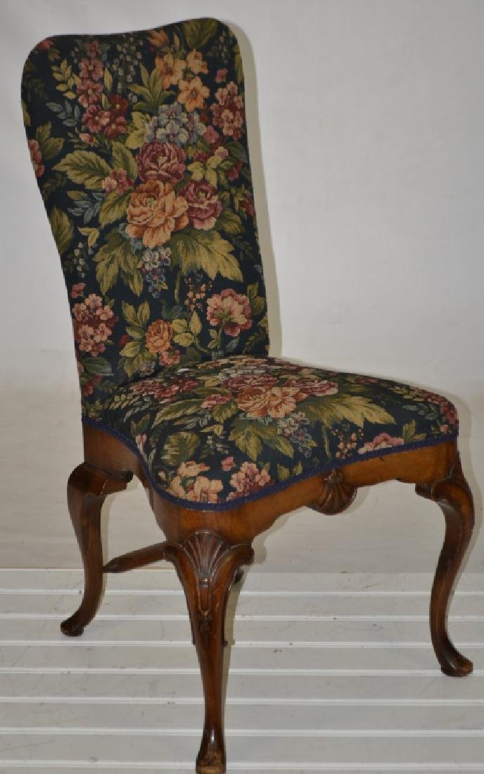 An Upholstered Chair with Shell Carving