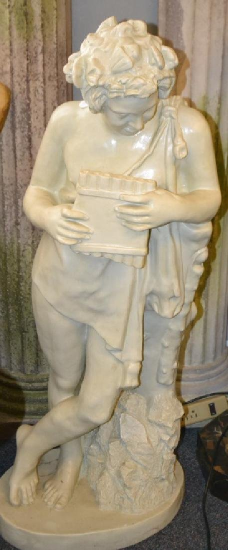 Large Figure Playing a Pan Pipe