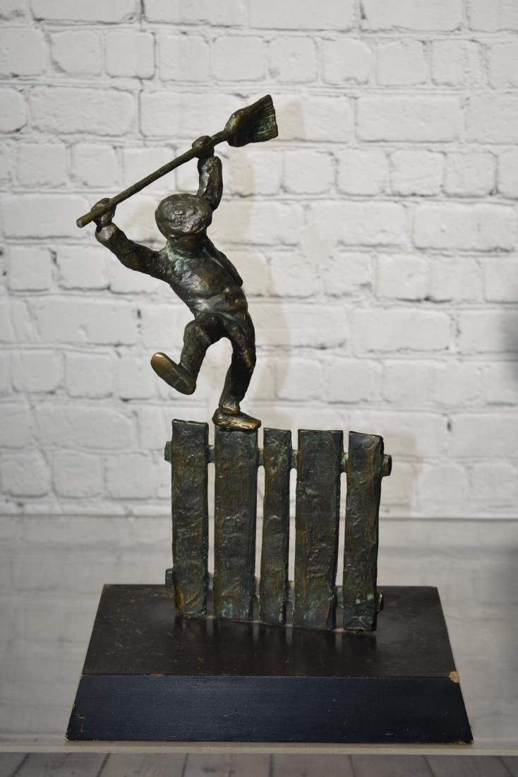 Bronze of a Boy on a Fence