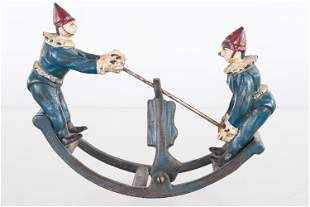 Vintage Cast Iron Clown Seesaw Toy