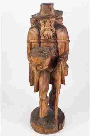 Carved Wooden Figure of Traveler