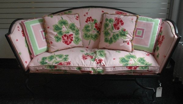 8: AN UPHOLSTERED IRON SETTEE