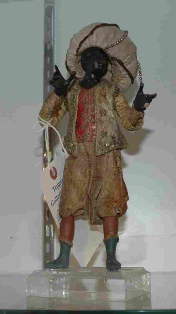 82: A CARVED WOOD AND SILD CRECHE FIGURE