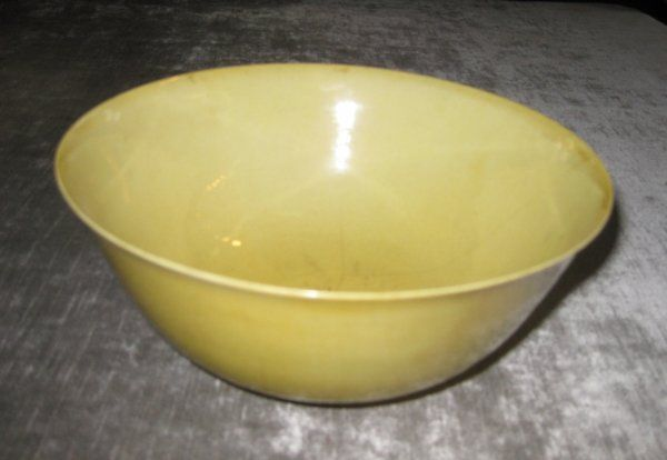 A CHINESE YELLOW-GLAZED PORCELAIN FOOTED BOWL WITH