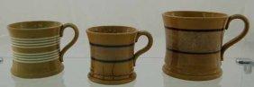 17: 3 Yelloware banded mugs