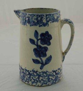 """21: Blue 9"""" spongeware pitcher w/ blue embossed flower"""