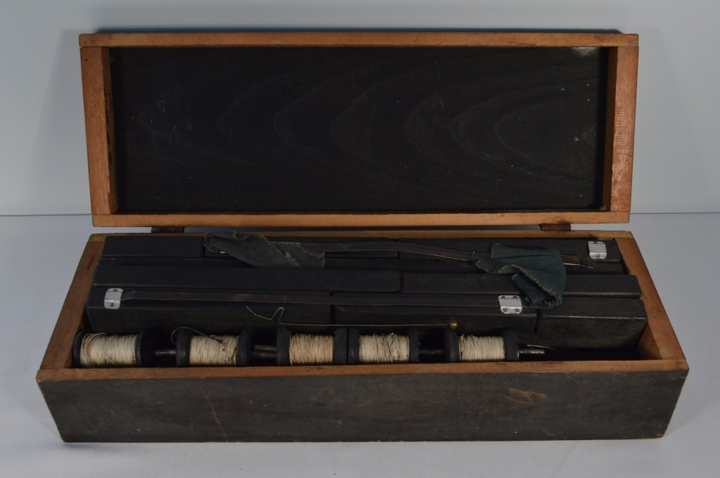 Ice Fishing Tip Up Kit in a Black Wooden Box