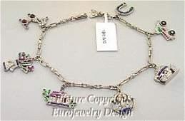 106 Estate Charm Bracelet w Rubys Emeralds Sapph