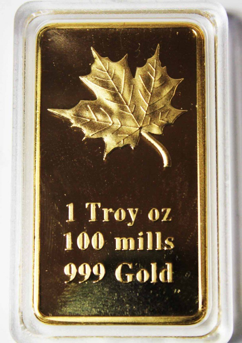 135: 1oz. 24k .999100 Mills Gold Maple Leaf Clad Bar Mi