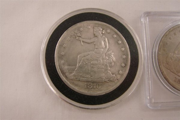 155: 2 US Silver Dollars including an 1870 Liberty Seat