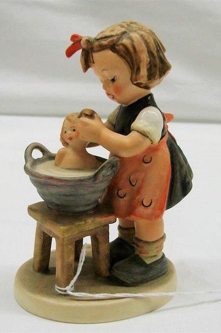 "19: Hummel Figurine: ""Doll Bath"" # 319, TMK 5. Book Val"