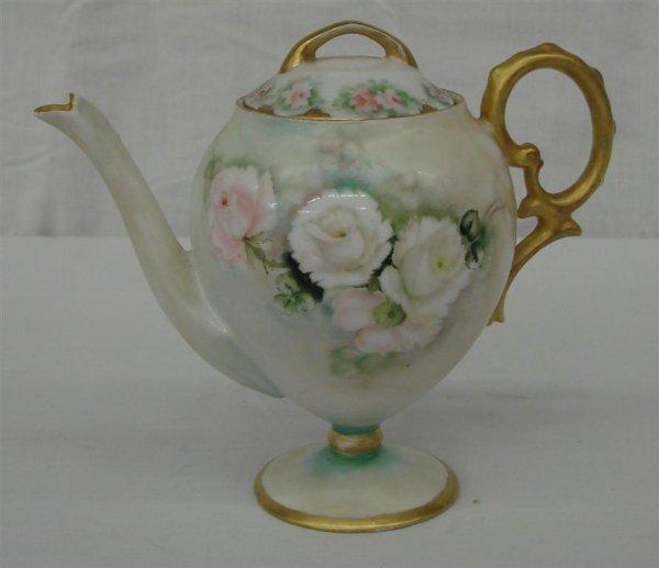 18: Antique Handpainted Pedestaled individual Teapot