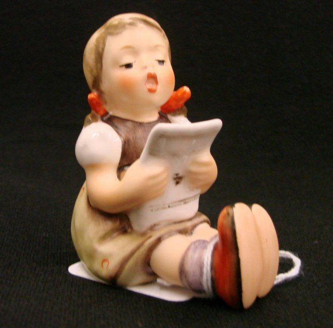 1: Hummel Figurine: Girl with Sheet Music, #389; TM 6.