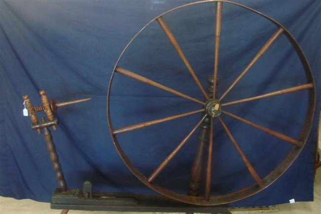 384: Large Antique Spinning Wheel. Auction Estimate: $2