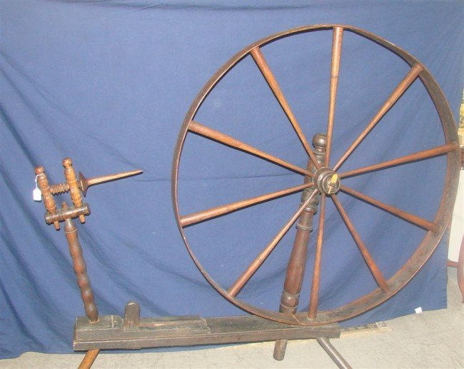 384: Large Antique Spinning Wheel. Auction Estimate: $2 - 3