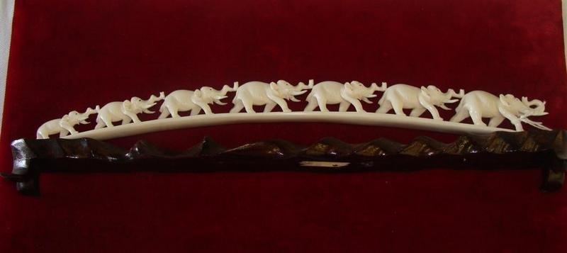 355: Antique Carved Ivory 7 Elephant Bridge on Teak Sta