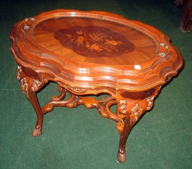 2020: Heavily carved walnut side table with inlaid flow