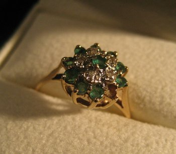 3013: 14Kt. yellow gold Emerald and Diamond ring