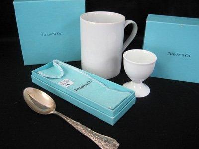 Three Tiffany & Co. items: spoon, mug & egg coddler