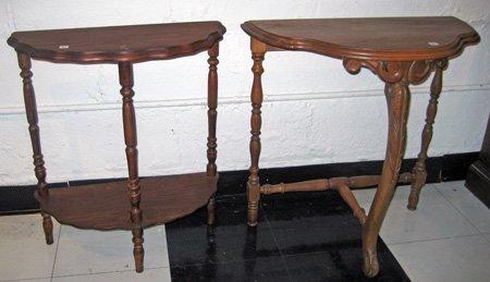 Two walnut demi-lune side tables - one with lower shelf