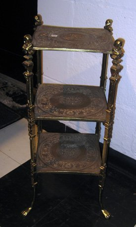 Ornate brass plant stand with figural supports
